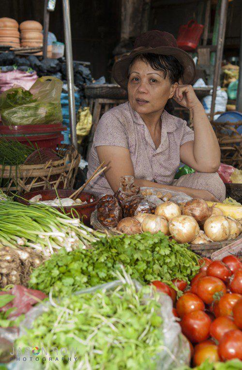 Vietnamese woman seeling fruit in a Danang Market