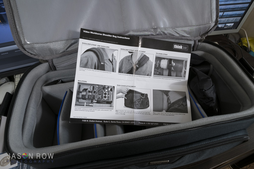 A camera bag with instruction manual.