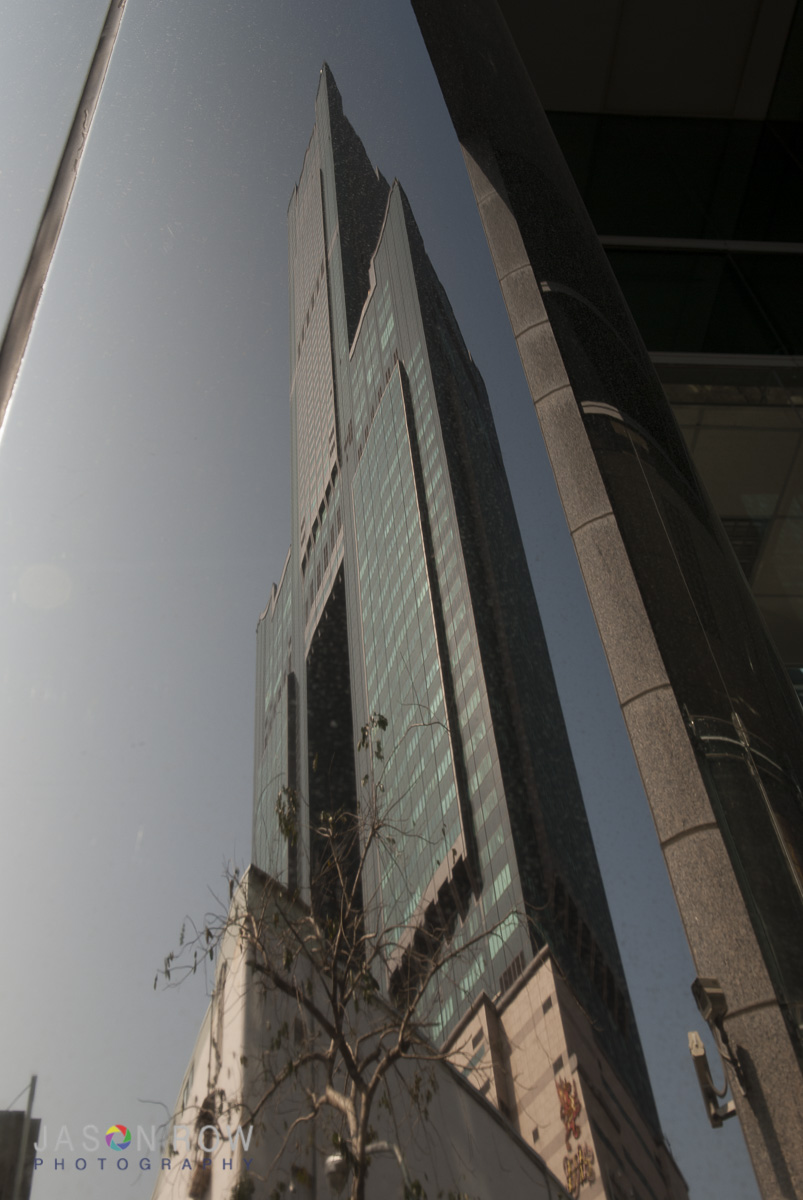 Tower 85 in Kaohsiung reflected in the metal of another building. By Jason Row Photography