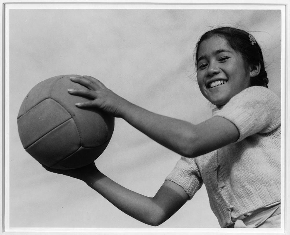 Girl and volley ball, Manzanar Relocation Center, California