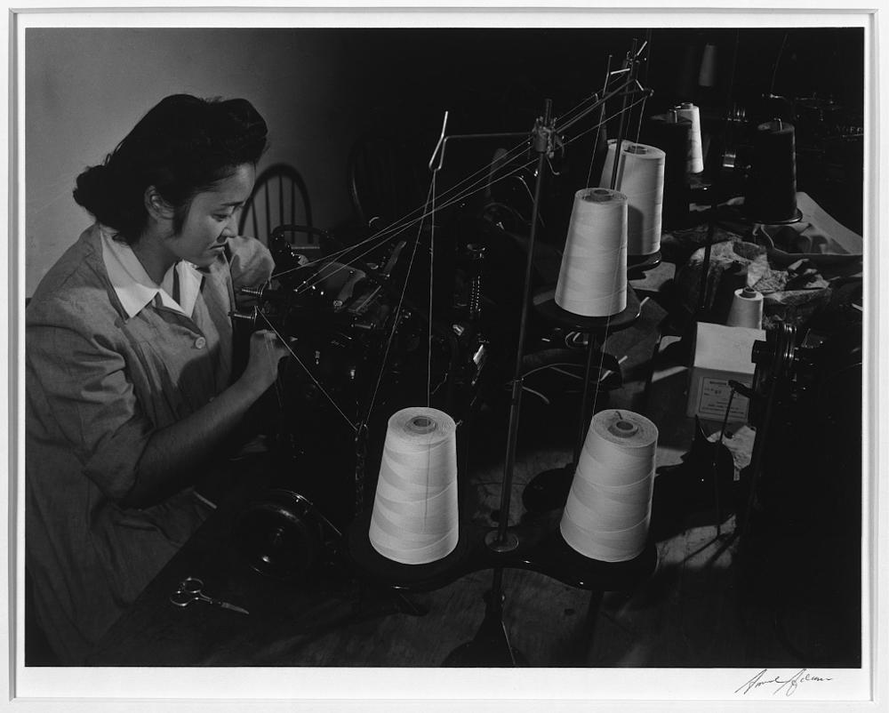 Sumiko Shigematsu at power machine, Manzanar Relocation Center, California