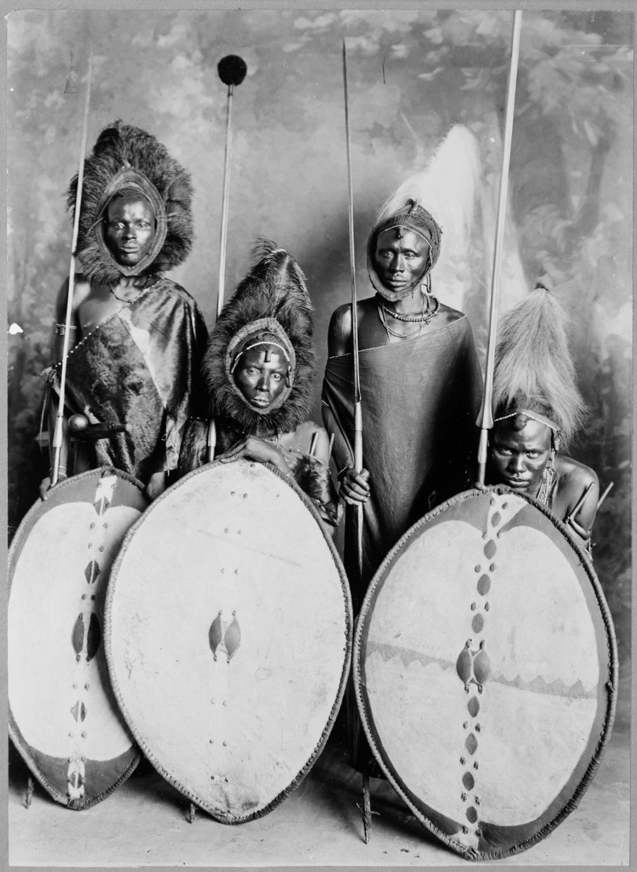 Four masai warriors in full war dress, Kenya