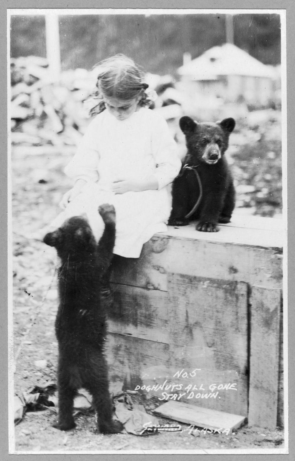Girl with bear cubs
