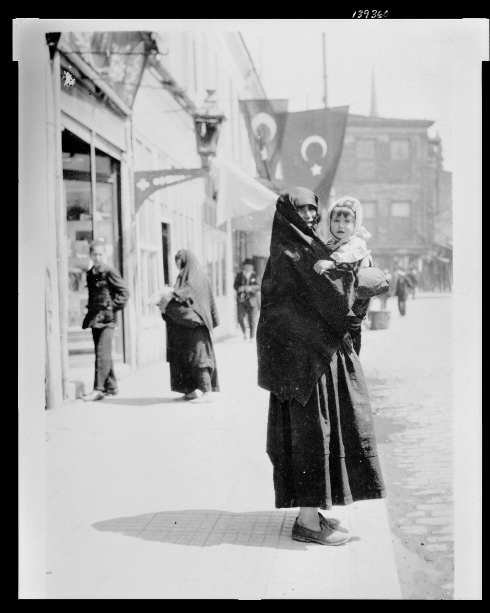 Woman holding a baby on a street in Istanbul