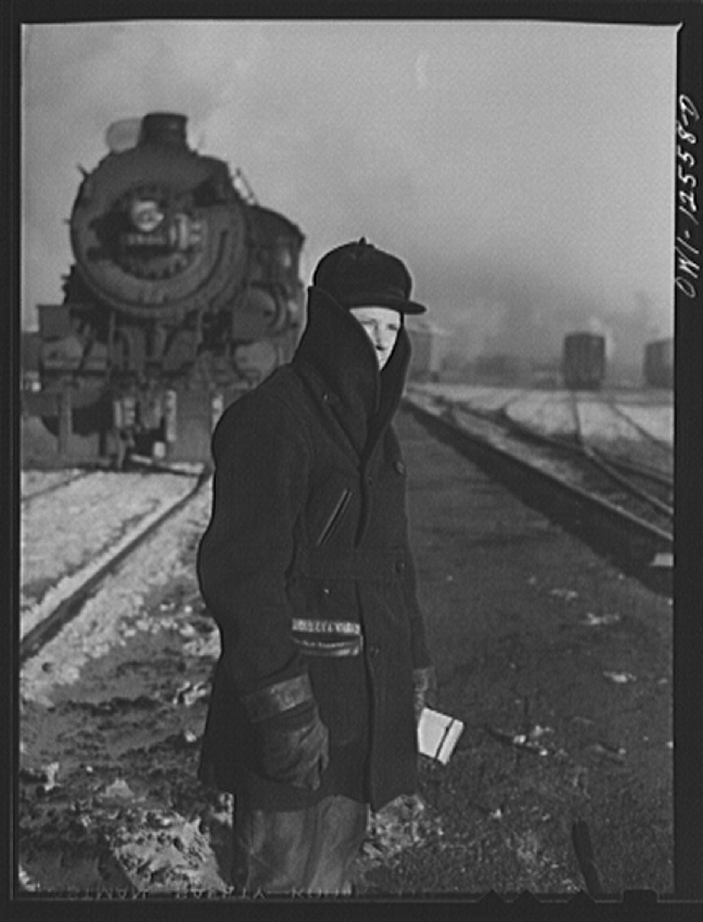 Chicago, Illinois. Switchman waiting for the train