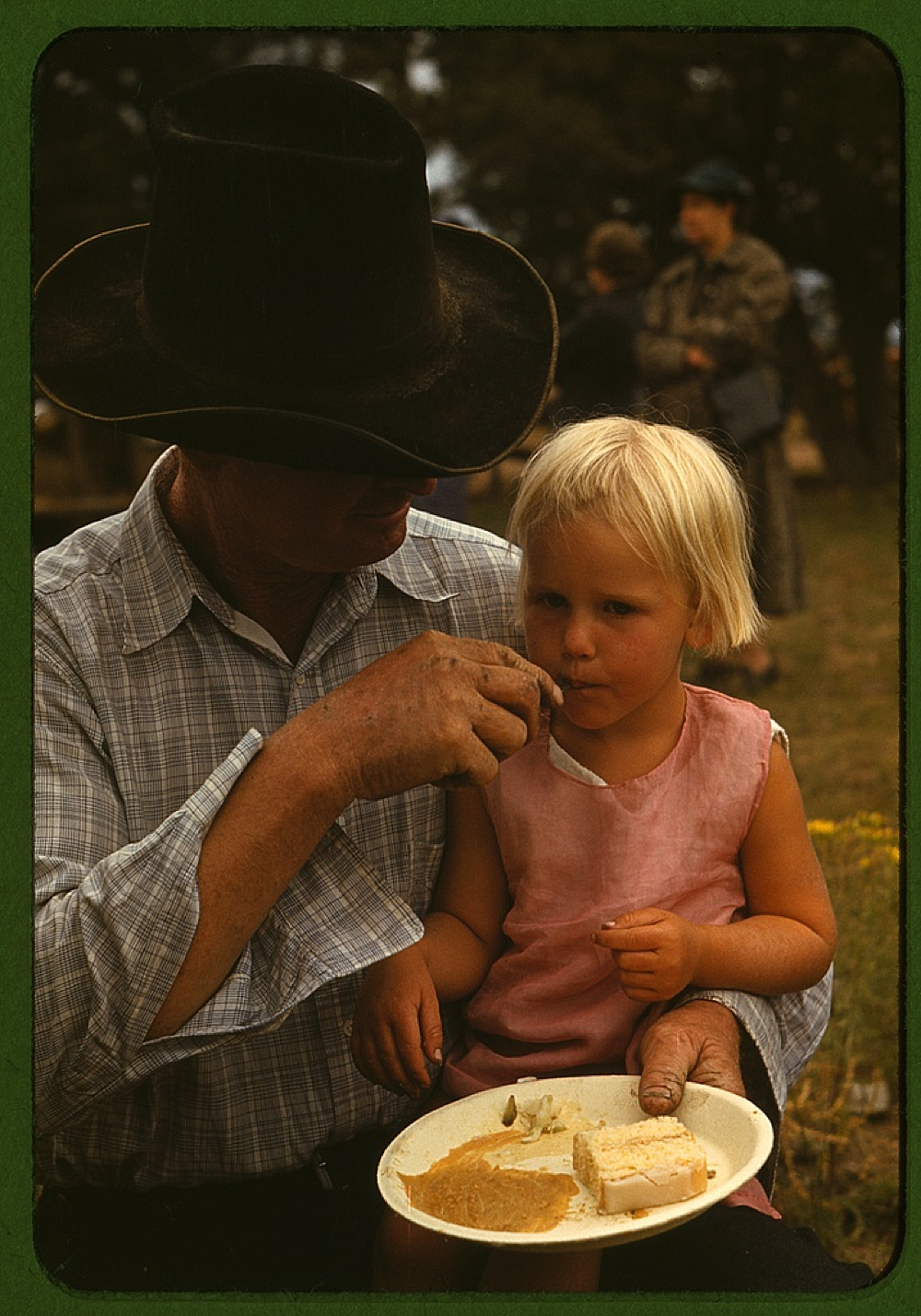Homesteader feeding his daughter at the Pie Town