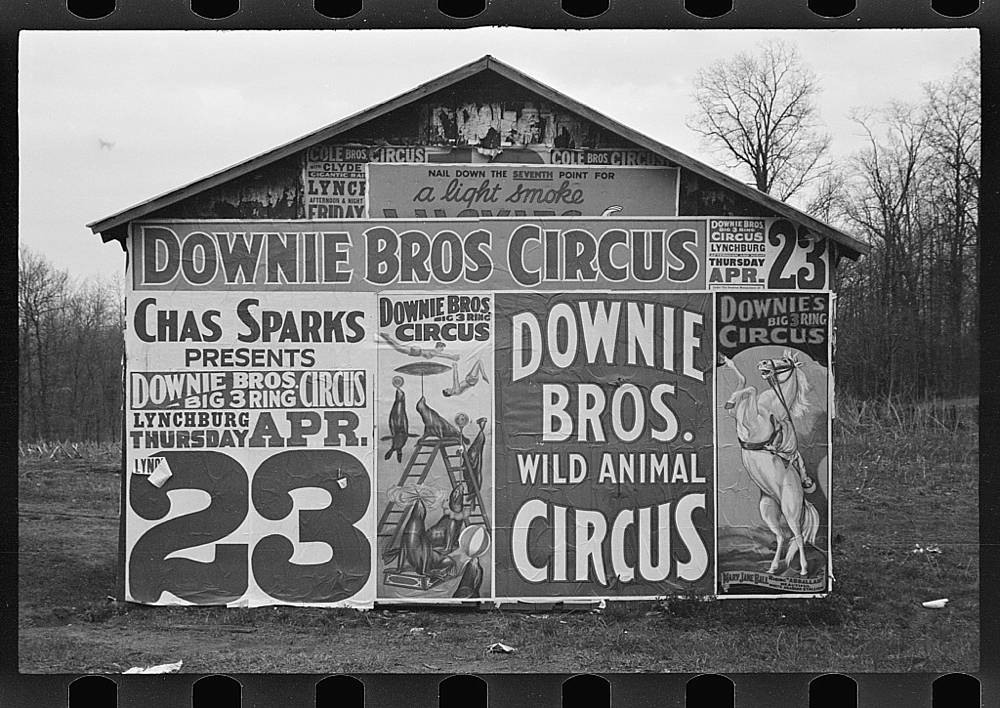 Posters covering a building near Lynchburg to advertise a Downie Bros