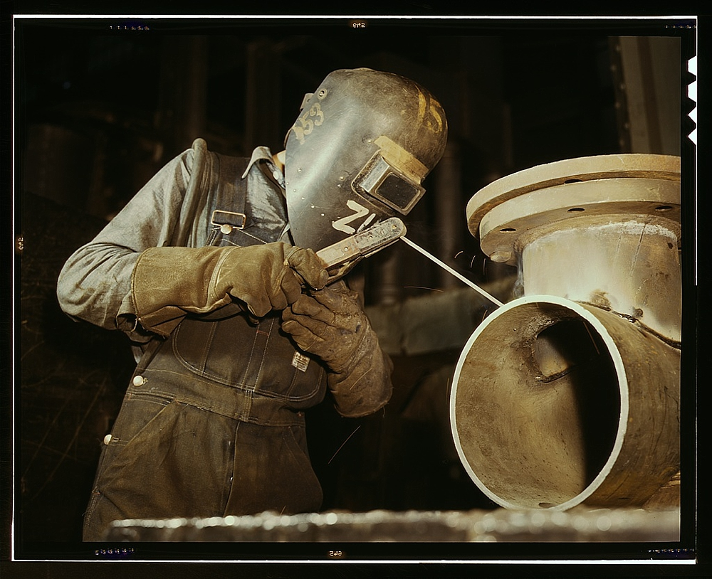 Welder making boilers for a ship