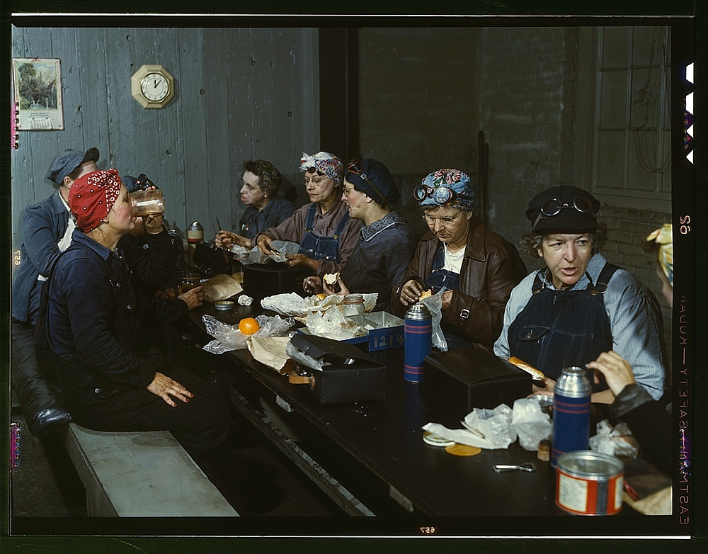 Women workers employed as wipers in the roundhouse having lunch in their rest room