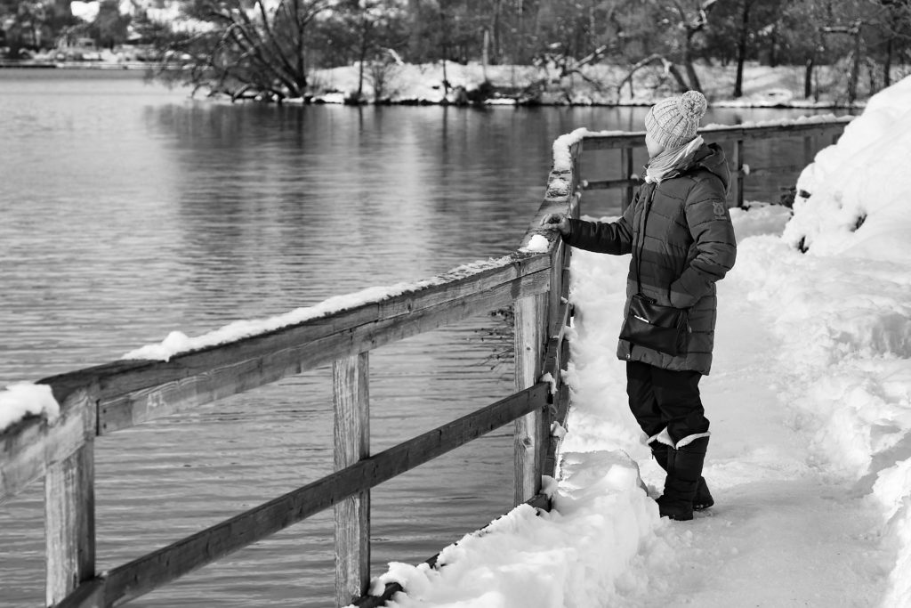 River with snow and girl in black and white