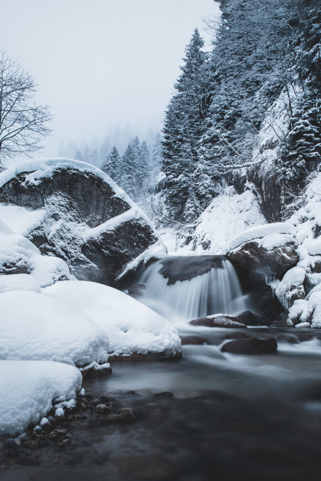 River with snow in black and white