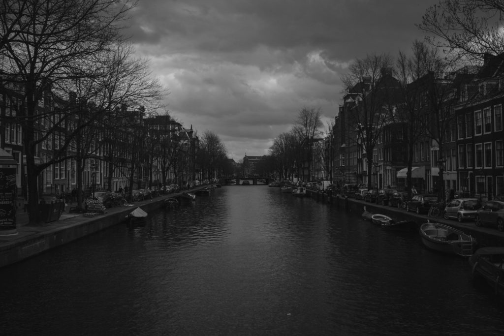 River and buildings in black and white