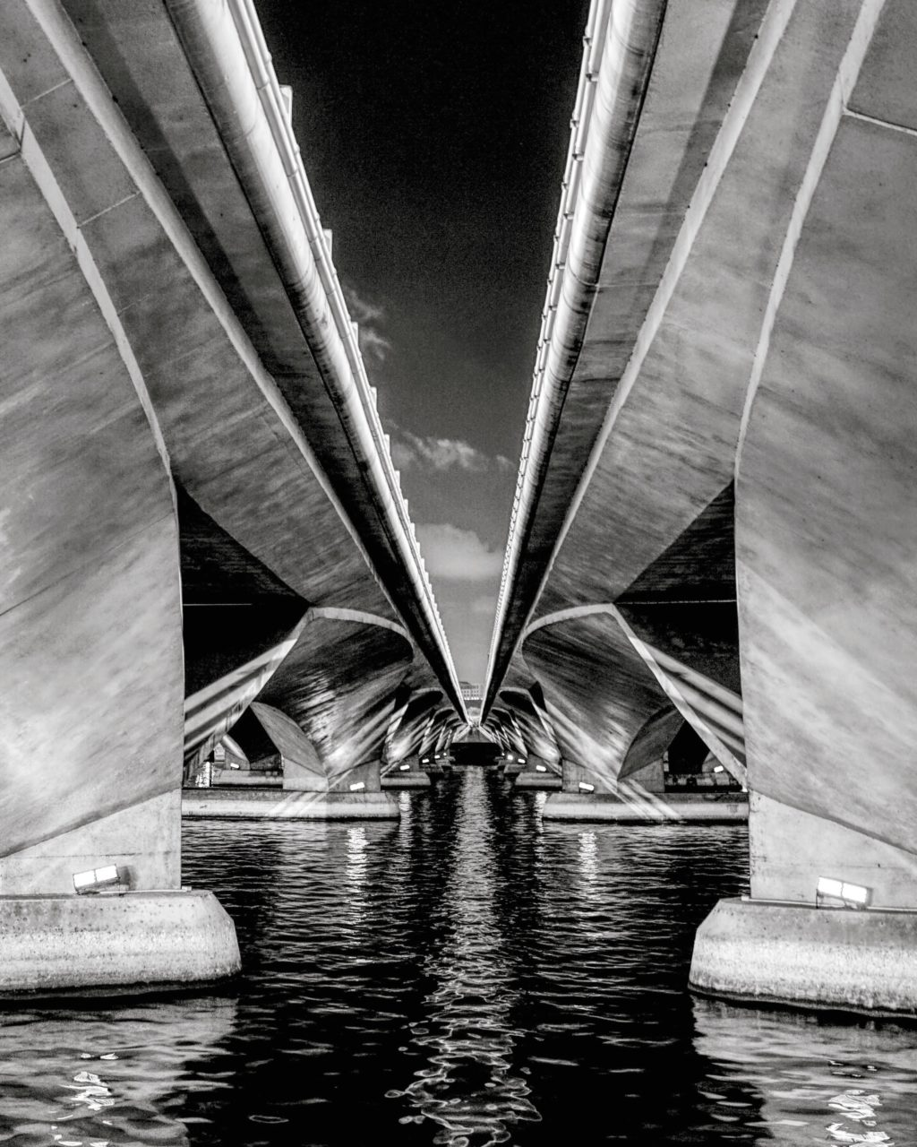 River and bridge in black and white