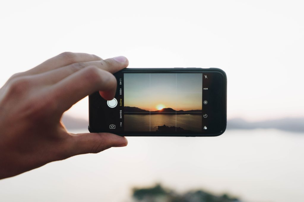 Photo of mobile phone taking photo of sunset