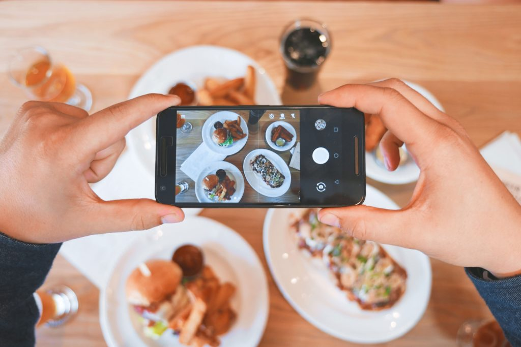 Photo of phone taking photo of dinner