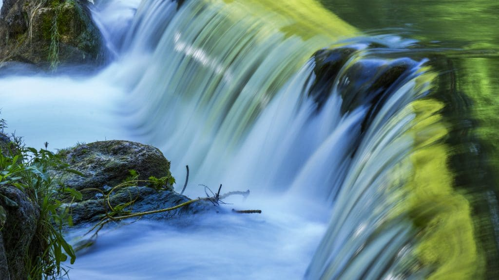 waterfall with green light
