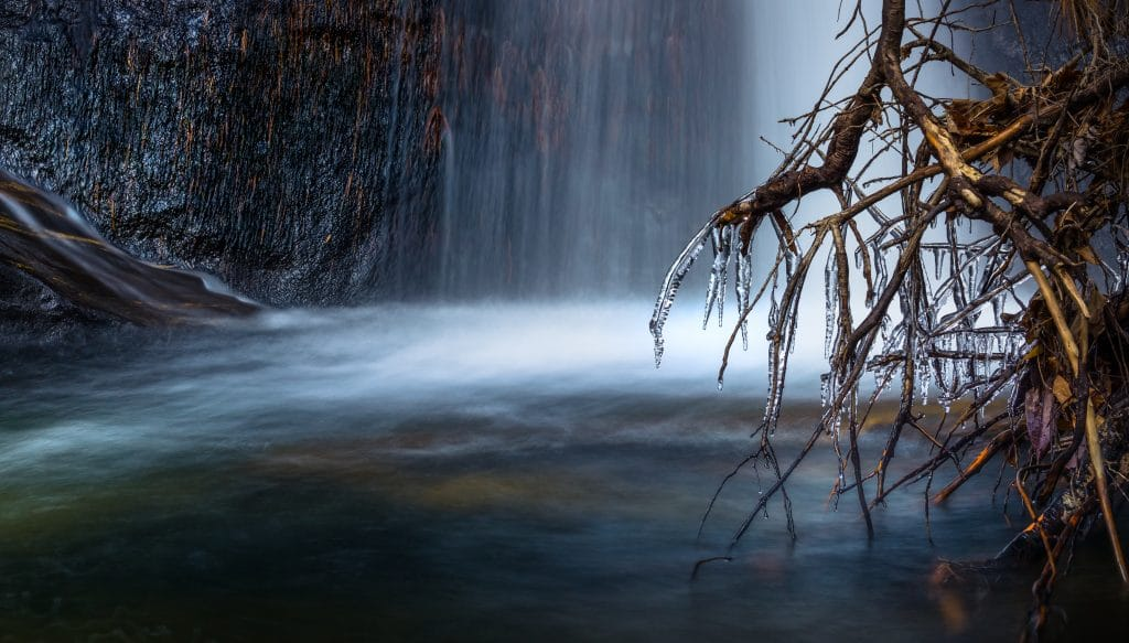 Waterfall with foreground branches