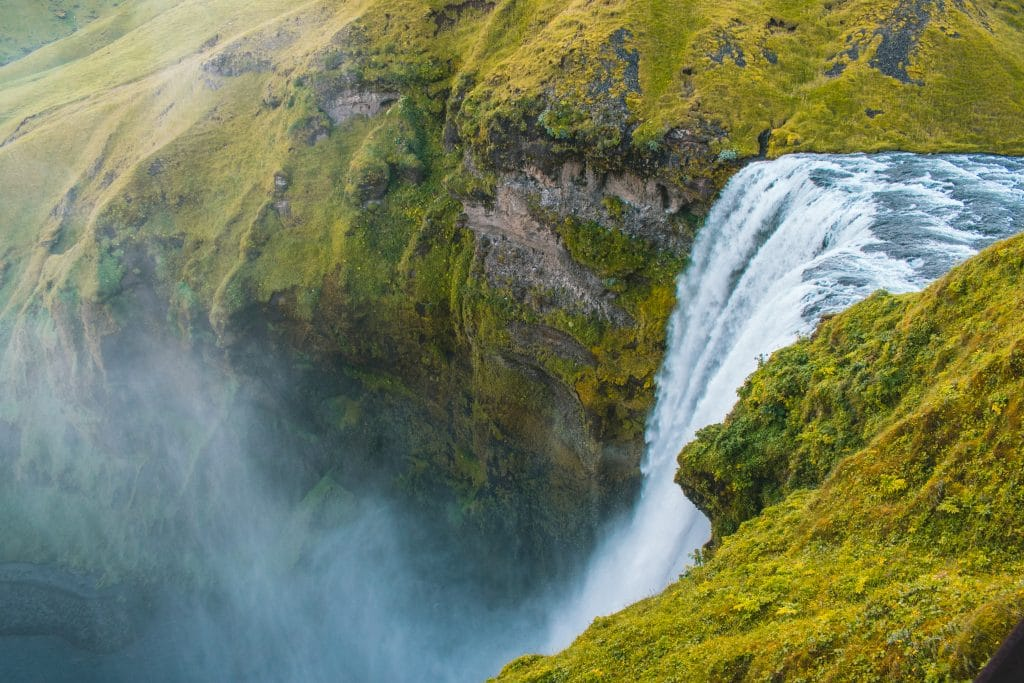 Waterfall from the top falling into an abyss